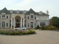Two story mansion with gravel driveway